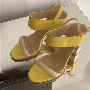 Yellow and white heels